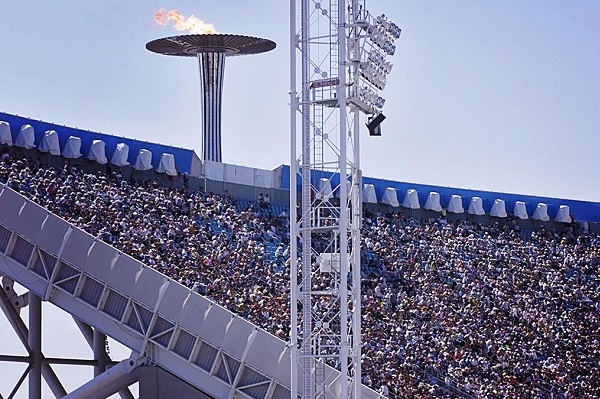 Inside the Sydney Olympic Stadium showing crowd and Olympic Flame